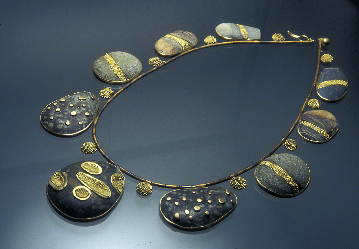 """New Zealand Beach"" Materials: l8kt gold granulation, sterling silver, New Zealand beach pebbles."
