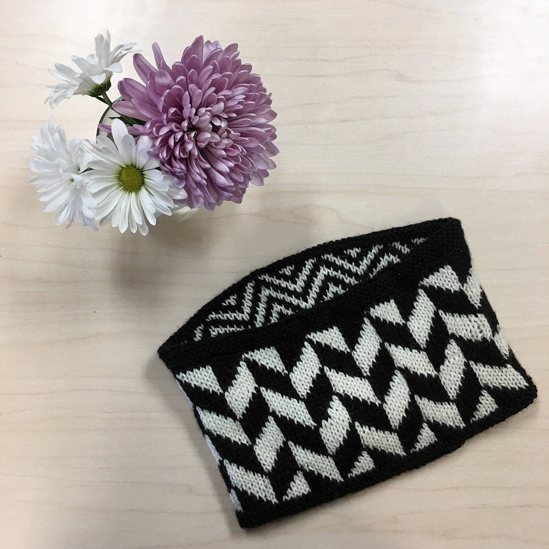 The Equilibrium Cowl is a gorgeous black and white colorwork kit that looks great with pastel colors