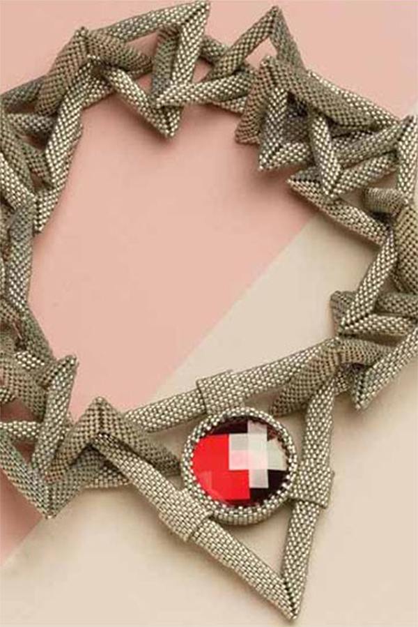 """Jean Power's """"Heroine"""" necklace features bold geometric shapes, a reversible rivoli focal which is stitched into the """"clasp."""" The clasp is woven sections that connect together using concealed magnetic clasps."""