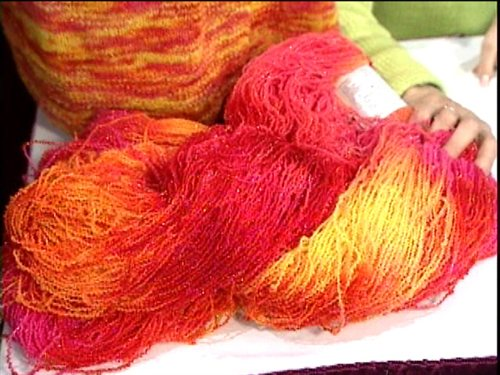 Sponsored by YarnMarket.com, Knitting Daily TV Episode 207 focuses on Cheryl Potter discussing her design work and inspiration for single skein projects.