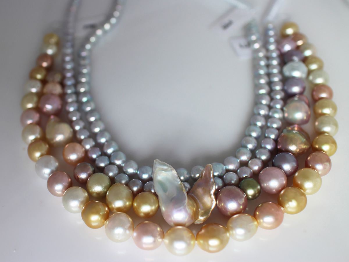 Gold and silver are not for precious metals only. These golden-colored and silver colored pearls offer so much more variety. The mix with the pink and baroque pearls is just fascinating. And what creative designer wouldn't give her eye-teeth to work with that glorious winged pearl in the center? Photo Betty Sue King. Courtesy Betty Sue King, King's Ransom.
