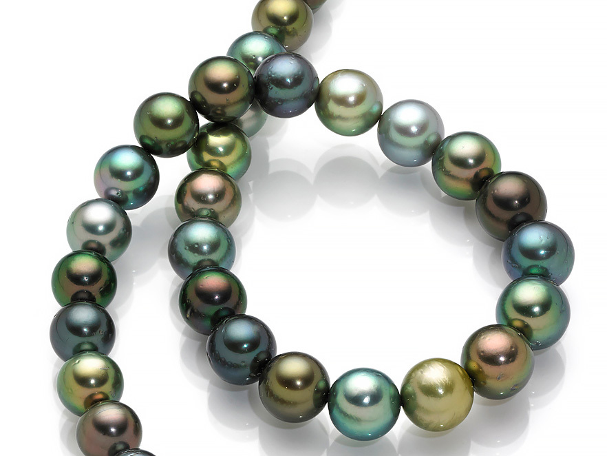 Tahitian pearls like these are in a class of their own with their unique body and overtone colors. Tahitian pearls are often larger than 10 millimeters, making them superb focal points for a strand and an absolute show-stopper when they are strung together like this. Photo John Parrish. Courtesy Betty Sue King, King's Ransom.
