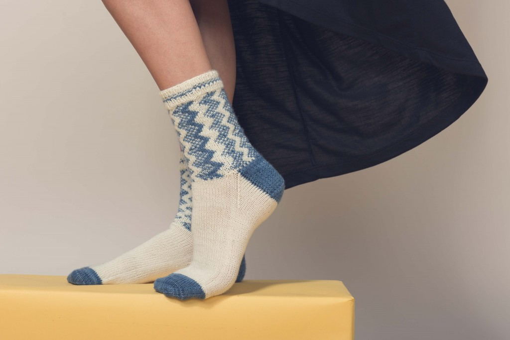 If you like knitted socks, then you'll LOVE this sock knitting pattern that includes vertical zigzags down the leg and are proven to warm your feet!