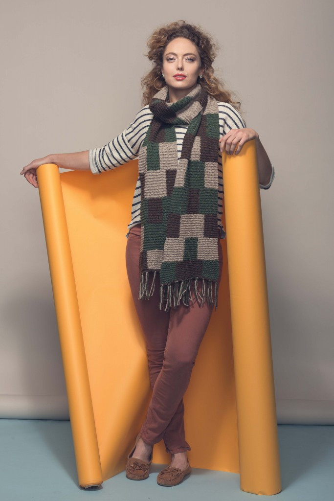 This knitted scarf pattern includes swaths of color, worked in blocks, that mimic the buffalo checks pattern of classic plaid fabric.