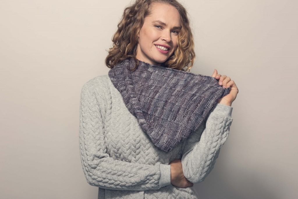 Combining subtle texture with slightly variegated yarn, this long looping cowl knitting pattern is a great accessory to snuggle into when it's cold outside.