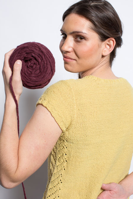 You'll love knitting the Grasslands Knitted Tee that involves a simple lace motif that graces the neckline and hip and is easy to knit!