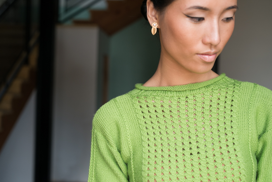 You'll love this knitted pullover pattern that has four panels forming its bottom and joined in the round in a combination of lace pattern and stockinette stitch.