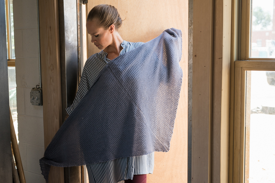 You have to try this top-down triangular shawl knitting pattern that utilizes a star stitch to achieve horizontal and vertical lines of texture.