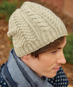 Looking for a knitted hat pattern that has lots and lots of fun cables? Check out this knitted toque.