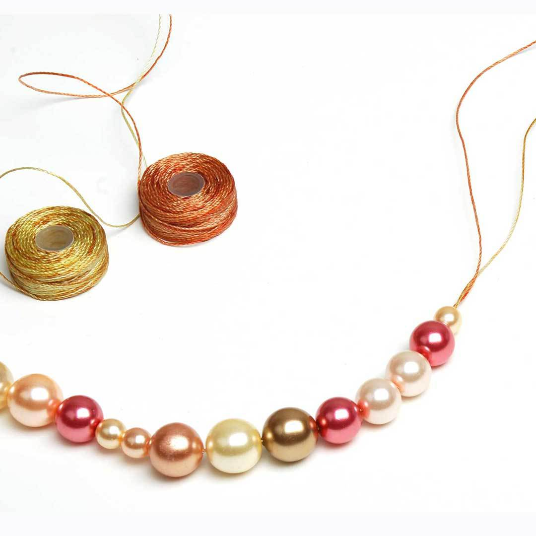 Two strands of contrasting cording enhances this necklace, but a single color or even a single strand still looks great.