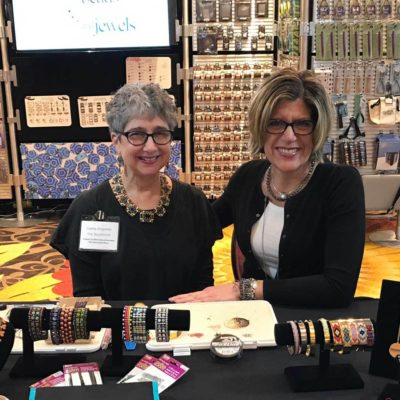 Leslie Rogalski with Tammy Honaman in the The BeadSmith booth during To Bead True Blue Show.