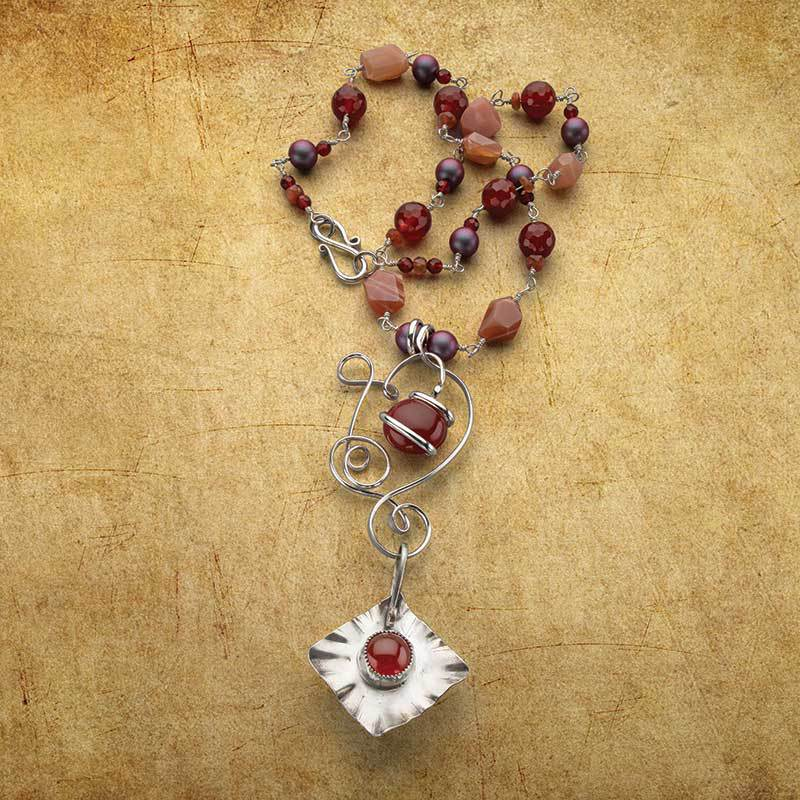 Carnelian is the perfect color for Fall and is worked beautifully in Sun Worship Duo jewelry project necklace by Sandra Lupo. Photo, Jim Lawson