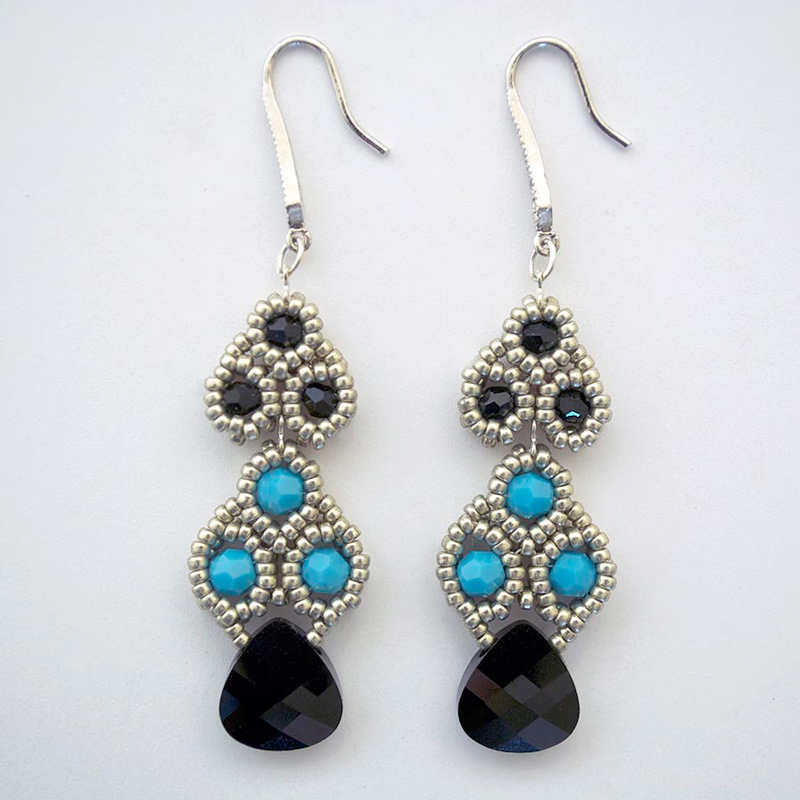 Bead artist Teresa Meister stitched these beautiful earrings with Swarovski crystal beads, seed beads and chain
