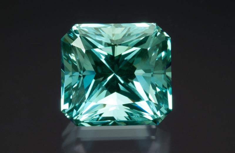 A square emerald-cut, greenish-blue aquamarine of 20.72 carats. Photo by Mia Dixon, courtesy Pala International.