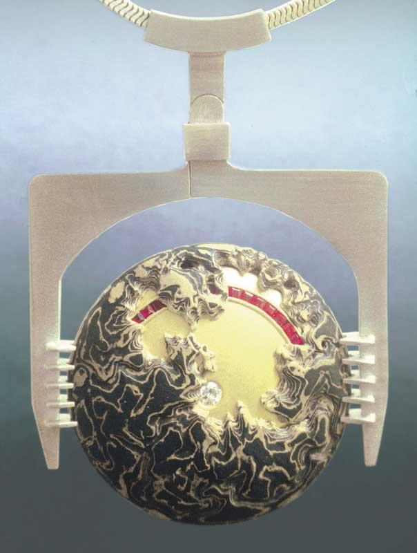 Disc Form IV mokume gane neckpiece by Steve Midgett. 18K gold, shakudo, 22K gold, and sterling silver with diamond and rubies.