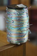 Novelty yarns like this can be weaving yarns, as long as you know how it's appropriate to use them.