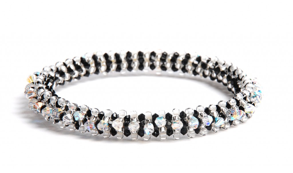 Prismatic right-angle weave bracelet, by Tammy Honaman. TOHO glow-in-the-dark beads, Swarovski cyrstals
