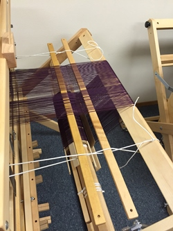 There are two weaving techniques for cutting projects off the loom. If you use two sticks, you can change the threading of your warp after cutting off a project without having to start over.