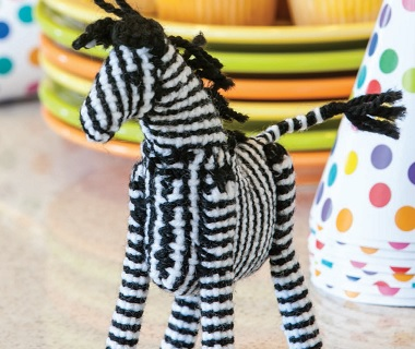 This zebra is a quick and fun pin loom project! Weave a whole dazzle of zebras.