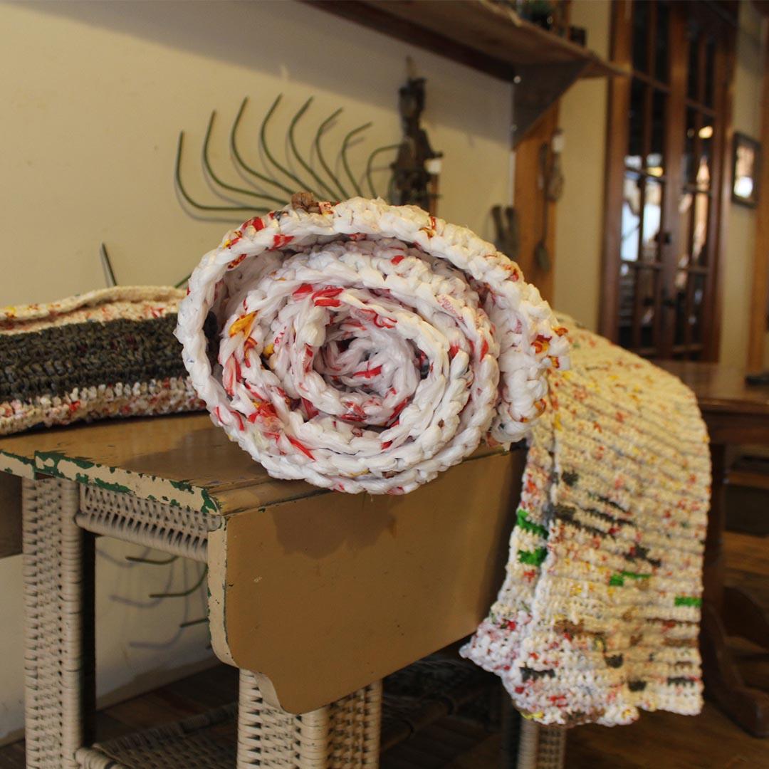 It can take upward of 1,500 plastic bags to make one mat.   Photo Credit: Shelene Codner