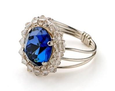 Make this Swarovski crystal ring inspired by Princess Diana's and Princess Kate's Ceylon sapphire engagement ring