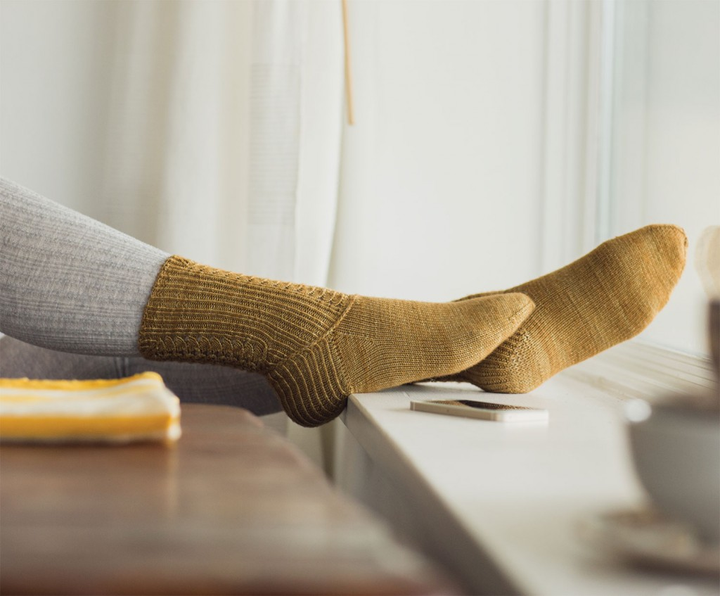 The knitted socks pattern, Purple Sage Socks, incorporates ribbing, mini-cable crosses and more to ensure your feet are cozy and stylish!