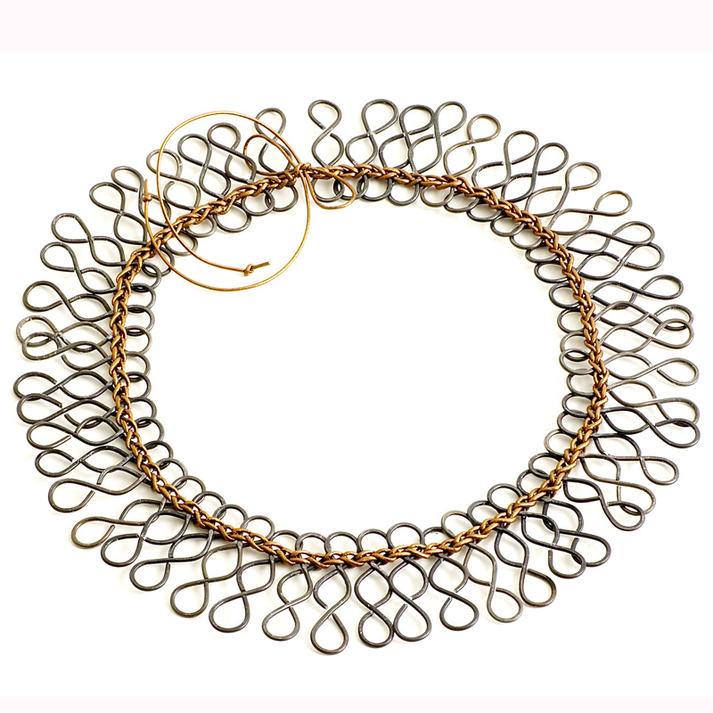Trinfiniti necklace by jewelry artist Brenda Schweder. Trinfiniti is made with steel wire and leather and was inspired by the repetition of the Trinfinity element.
