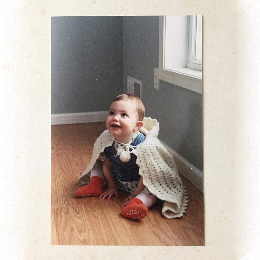 My daughter Lauren wearing her great-great grandmother's crocheted cape in 2004.