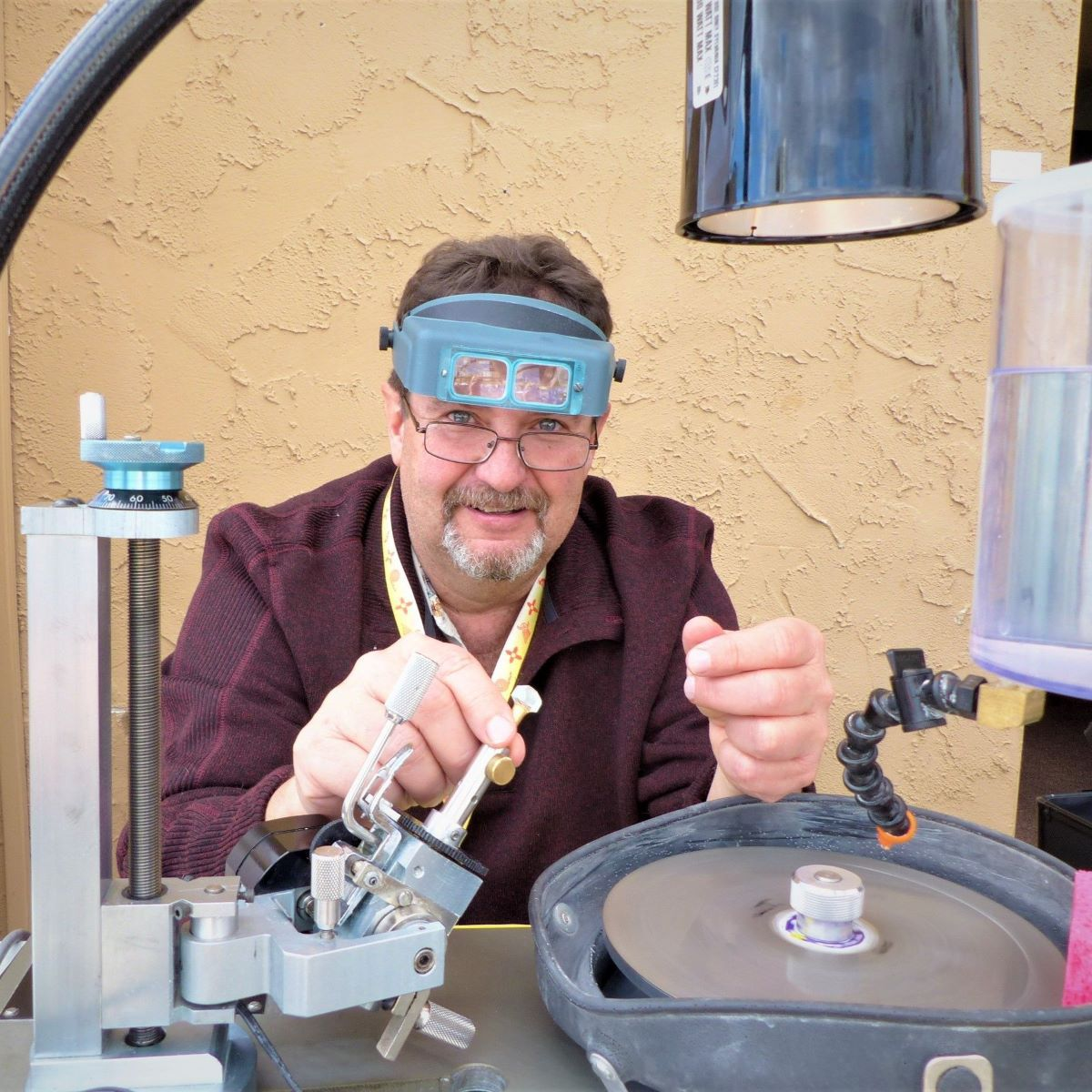 Jeff Theesfeld demonstrates gem faceting at one of the hotel venues in the Tucson gem shows.