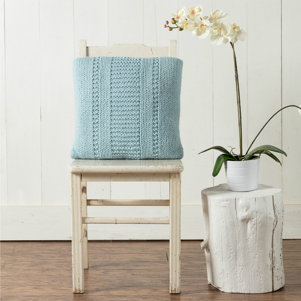 This textured handknit pillow knits up quickly and fits in with any decor.