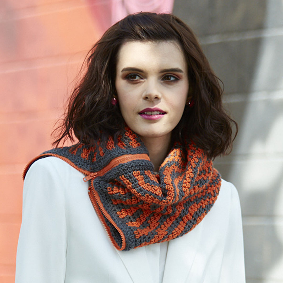 Tigre Zippered Cowl in gray and orange.   Photo Credit: George Boe
