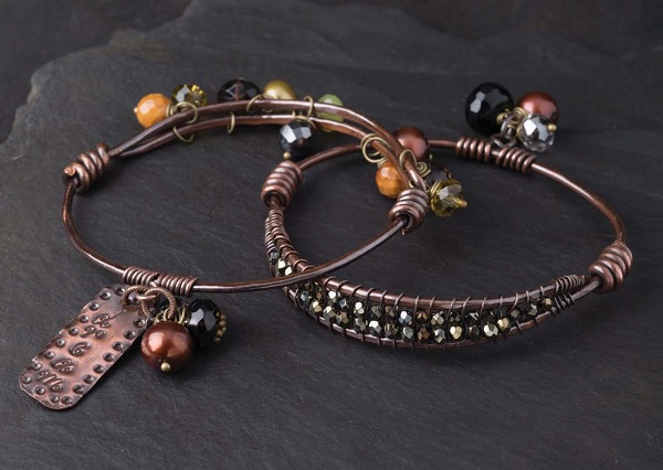 combing metal stamping, texturing, and wire coiling in the Woven In Time bangles by Tracy Stanley
