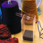 Winding a Warp: Two Threads with a One-and-One Cross