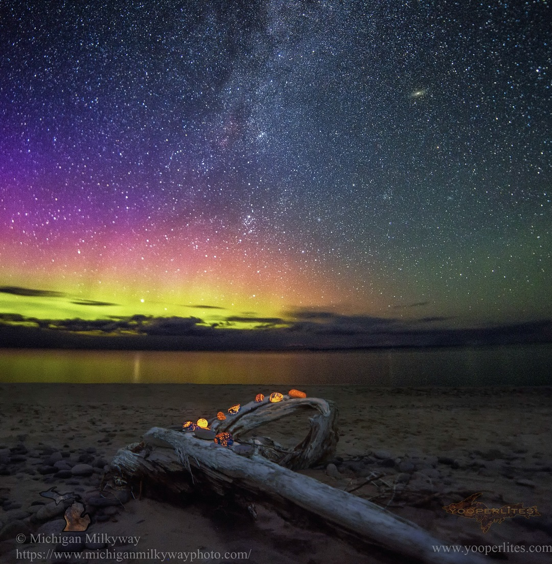 """Shelly Leigh, 36, of Kalamazoo, Michigan, specializes in nighttime photography. On August 31, a huge solar storm was forecast and produced Northern lights, which she spent the night imaging along with Erik's yooperlites. """"When I saw stories about these rocks, I thought I've just got to get a picture,"""" she says. """"We got lucky."""""""