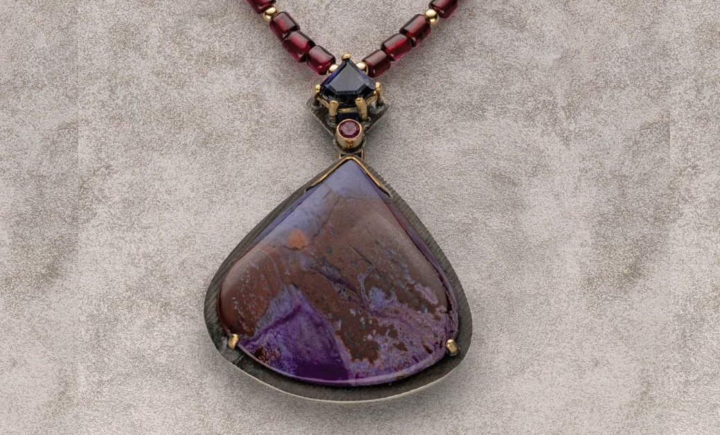 Noël Yovovich, Prongs Illustrated. Iolite, sugilite, garnet, sterling silver, 18K gold. Photo: Jim Lawson.