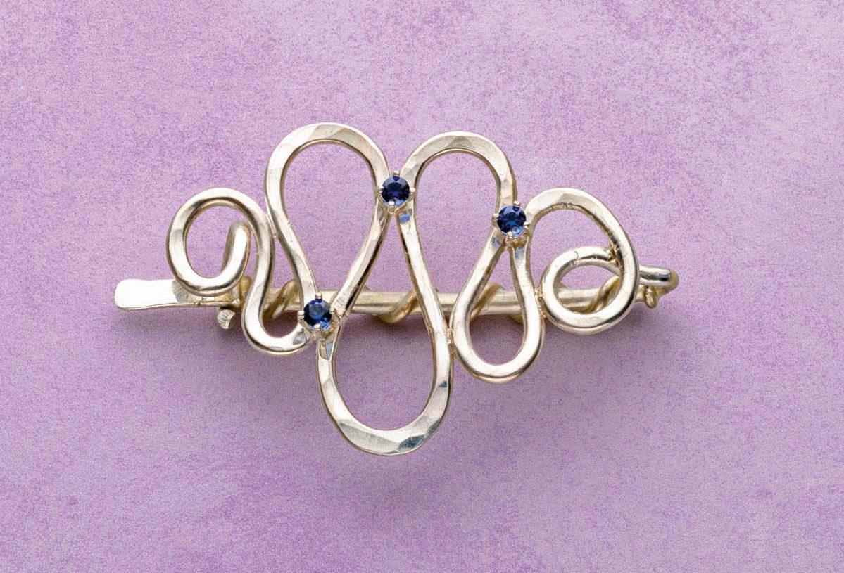 """Starlight in Her Hair"" by Noël Yovovich. Lab-grown sapphires, wire. Photo: Jim Lawson."
