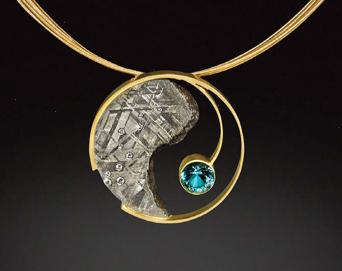 """Meet """"Star Powered"""" jewelry artist Jacob Albee, known for his jewelry using meteorite as both a """"gem"""" and a metal. This is his Yin Yang pendant featuring a slice of Gibeon meteorite, 18K gold, 1.96 ct. aquamarine, diamonds; photo courtesy Jacob Albee"""