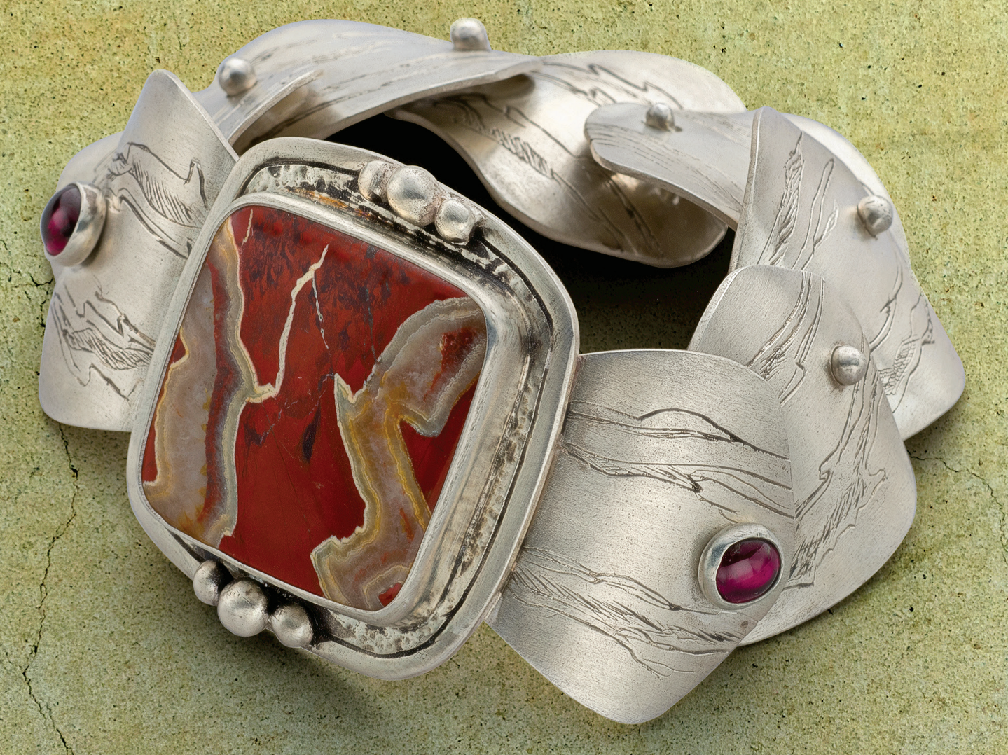 Classic crazy lace agate finds its way into contemporary jewelry such as Janet Alexander's Open & Close bracelet. The project appears in Lapidary Journal Jewelry Artist March/April 2018, in which this agate is also the featured Smokin' Stone. Photo: Jim Lawson