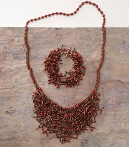 This is a beautiful beaded necklace and can be found in our FREE eBook on bead embellishments.
