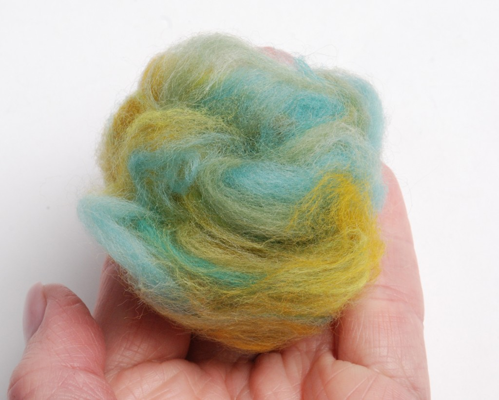 gather a piece of roving and shape into a loosely formed ball