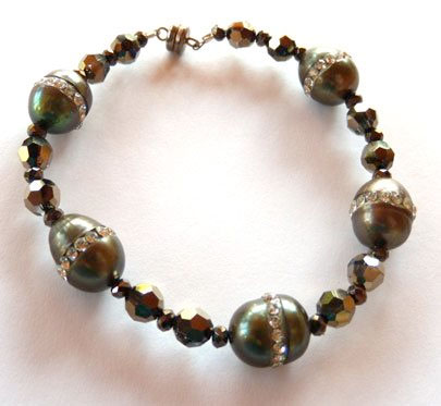 Freshwater pearls encrusted with tiny crystals and accented with round crystal beads