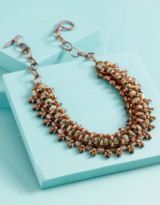 Learn how to make this beaded choker that involves embellishments and more.