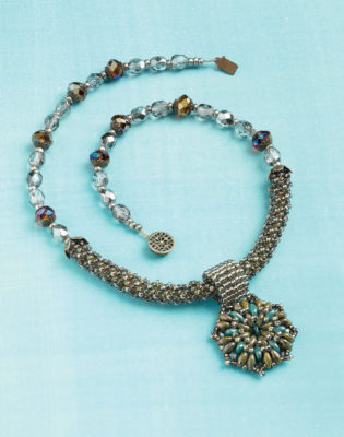 Learn how to make this free beaded necklace project that involves the circular peyote stitch with two-hole seed beads.