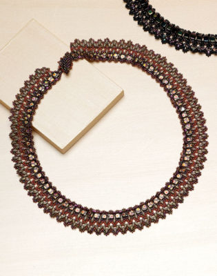 Learn how to make this Icelandic beaded necklace that incorporates right-angling and two different two-hole beads.