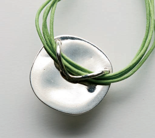 Hang it from the center or a corner: this bail design allows the piece to be worn either way; photo: Jim Lawson