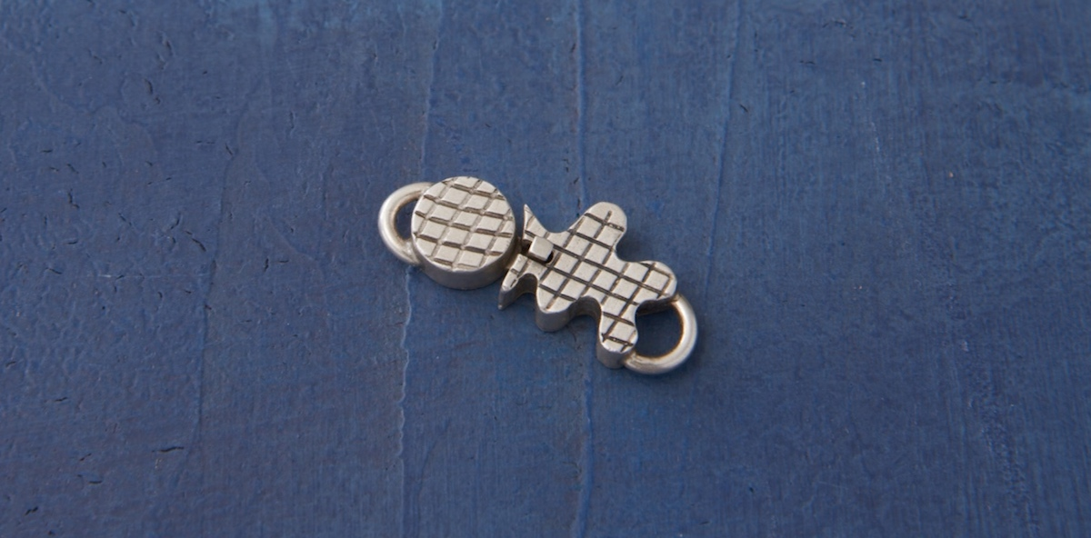 Richard's finished box clasp incorporates roller printed metal, jump rings, and a patina to bring out the contrast.