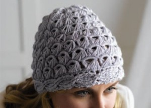 Learn how to make this cable crochet hat in this free guide.