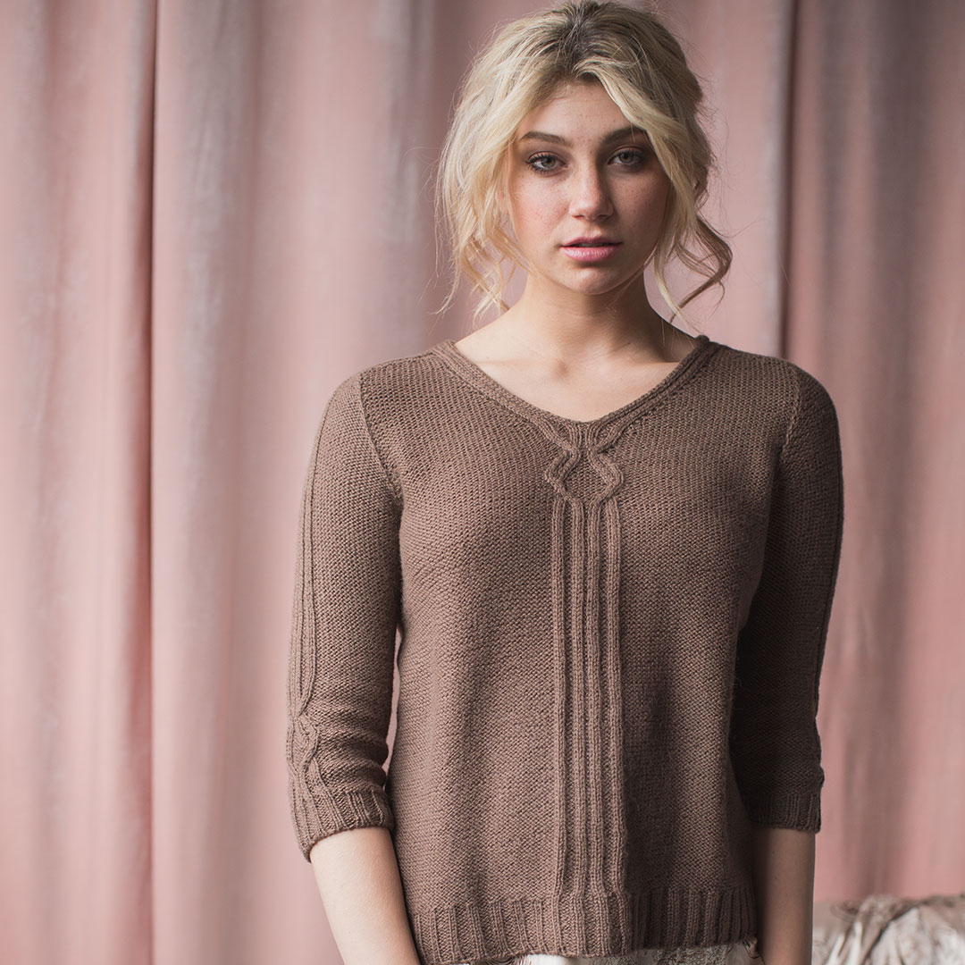 Ribbing, reverse-stockinette stitch, and a small bit of cabling create the simple-yet-fulfilling Calderwood Pullover.