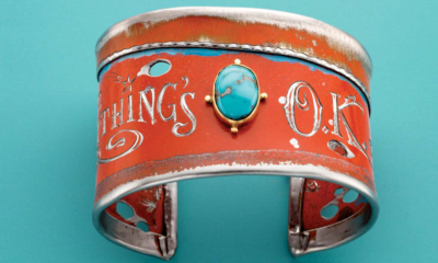 Kit Carson's Everything's O.K. Steel and Turquoise Cuff appeared in Lapidary Journal Jewelry Artist August 2017; photo: Jim Lawson