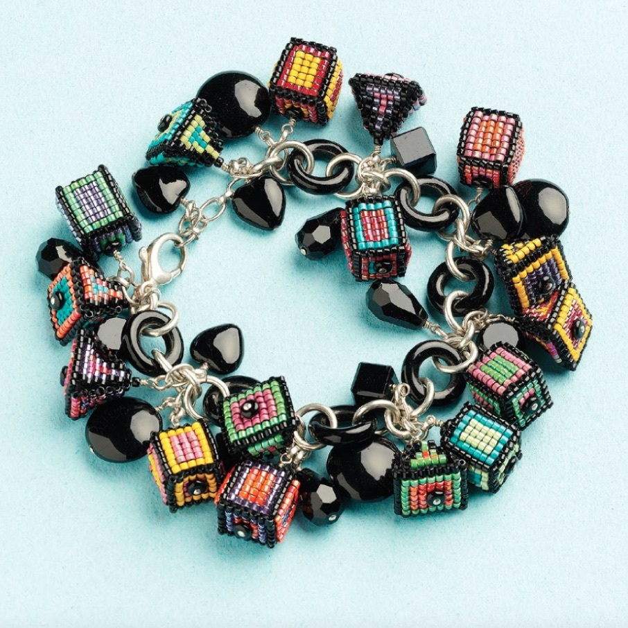 """Sue Jackson and Wendy Hubick incorporated colorful cube and pyramid beaded beads in this bracelet, Charmed, I'm Sure. Find it in the eBook <em><a href=""""https://www.interweave.com/store/12-beaded-bead-projects-to-make-download"""" rel=""""noopener"""" target=""""_blank""""> 12 Beaded Bead Projects to Make</a></em>."""